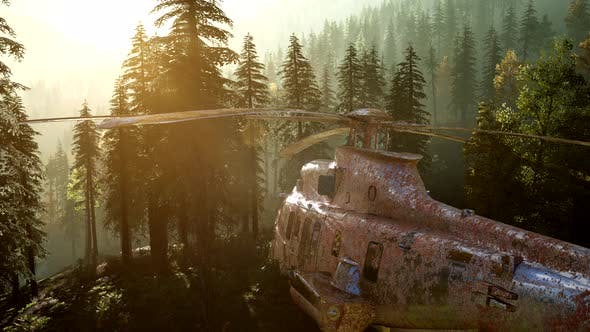 Thumbnail for Old Rusted Military Helicopter in the Mountain Forest at Sunrise