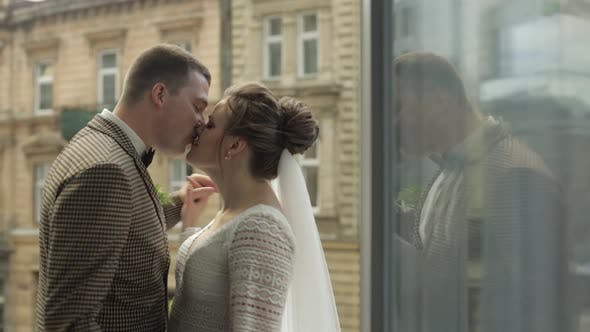Newlyweds. Caucasian Groom with Bride Dancing on Balcony. Wedding Couple. Man and Woman in Love