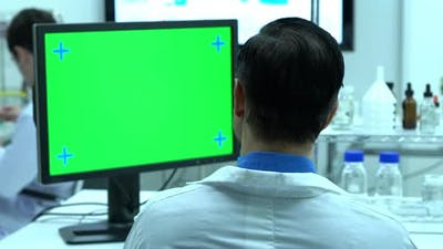 Scientist with green screen
