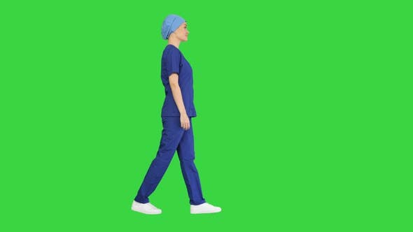 Thumbnail for Confident Nurse or Doctor in Blue Uniform Walking Towards the Camera on a Green Screen, Chroma Key.