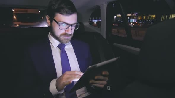 Thumbnail for Businessman with tablet in car