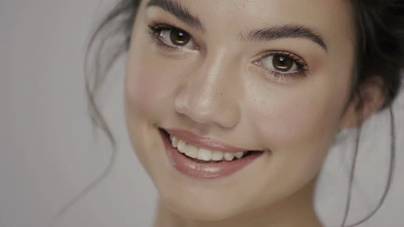 Thumbnail for Pretty Woman Face with Golden Make-up Smiling To Camera on Grey Background