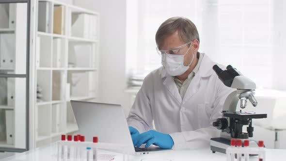 Thumbnail for Biomedical Scientist Doing Research and Typing on Laptop