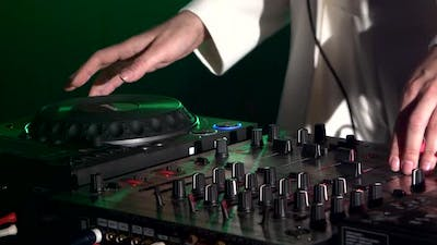 Dj Hands on Stylish Equipment Deck, Dancing and Playing, Close Up, Green Backlight