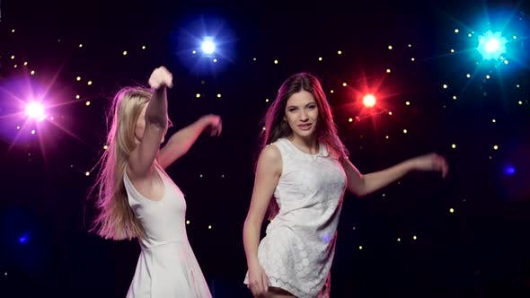 Thumbnail for Sexy Woman Dancing Together in Front of Disco Style Lights