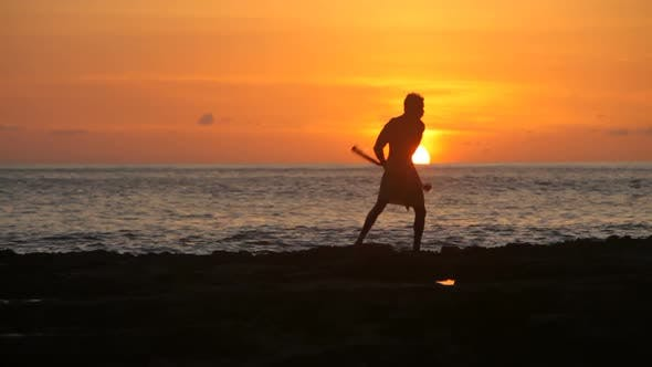 Thumbnail for Hawaiian fire knife dancer performs at sunset