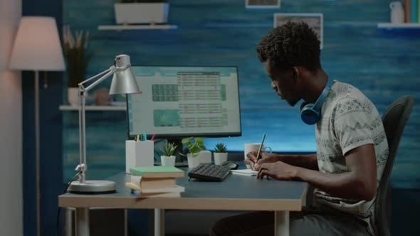 Black Man Looking at Stock Market Exchange Information