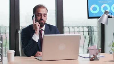 Medium Shot of Business Person Talking on the Phone