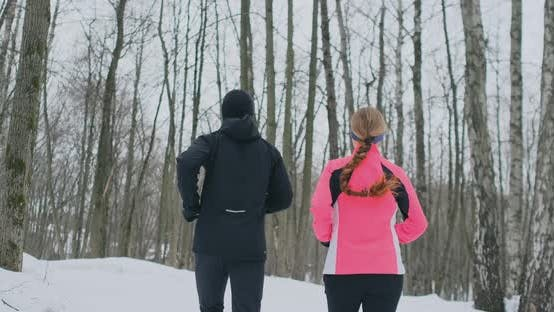 Thumbnail for Young Healthy Couple Running with Sportswear Through the Forest