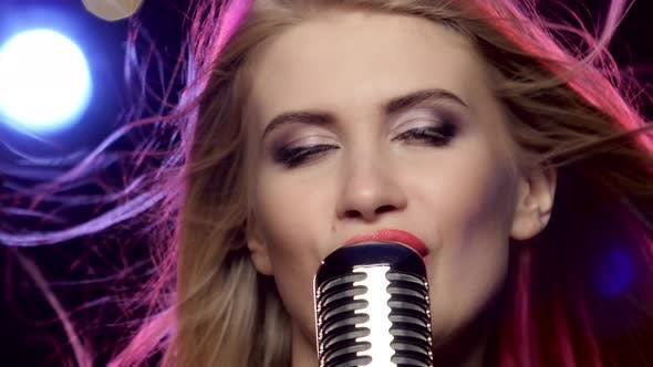 Thumbnail for Glamour Singer Girl with Retro Microphone Long Blonde Hair Developing