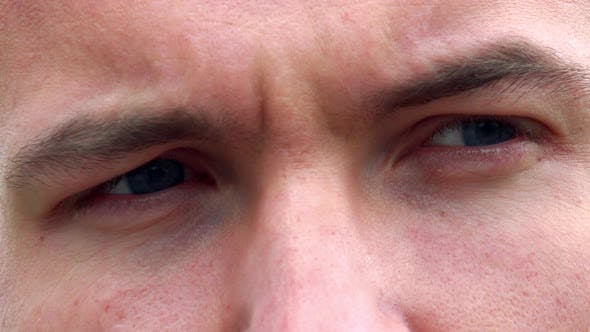 Thumbnail for Young Sad Man Looks Around - Detail of Eyes Expression