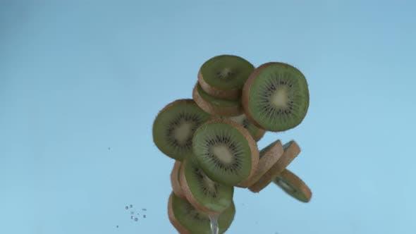 Thumbnail for Sliced kiwi flying in slow motion, shot with Phantom Flex 4K at 1000 frames per second