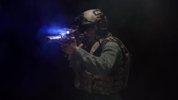 US Special Forces Soldier Aiming with Rifle at Night in Darkness