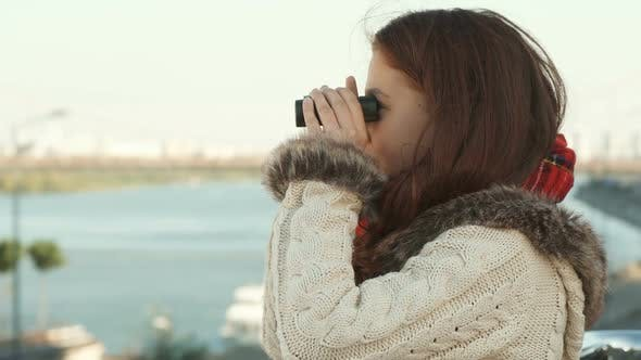 Thumbnail for Curious Girl Is Looking Through Binoculars