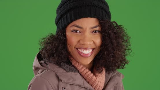 Thumbnail for Black woman rubbing her nose with her gloves during winter cold on green screen