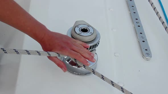 Thumbnail for Closeup Male Hands Securing Rope on Yacht, Preparing to Sail