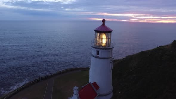 Thumbnail for Aerial shot of Heceta Head Lighthouse at sunset, Oregon