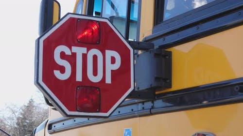 School Bus Stop Paddle Opens