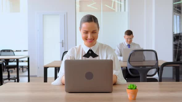 Thumbnail for Portrait Businesswoman Using Laptop at Workplace