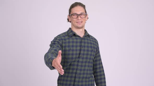 Thumbnail for Happy Hipster Man Smiling While Giving Handshake