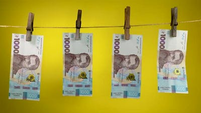 Ukrainian Currency is Dried on a Rope