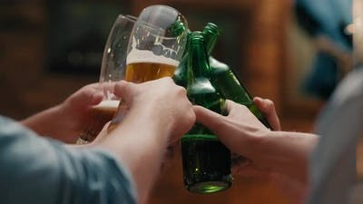 Friend with beer glass making a cheers