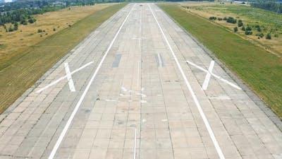 Airplane Landing on Airport Runway
