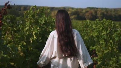 Happy Woman Winemaker Running in Her Vineyard