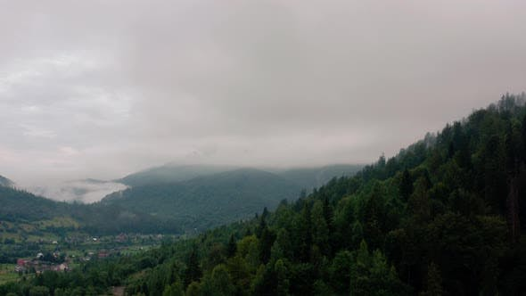 Cover Image for Aerial View Over Foggy Mountains After Rain V3