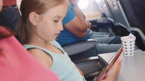 Adorable Little Girl Traveling By Plane
