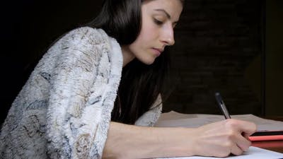 Young Woman Reading Theory and Preparing for Lectures