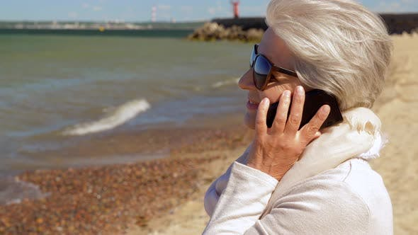 Cover Image for Senior Woman Calling on Smartphone on Summer Beach
