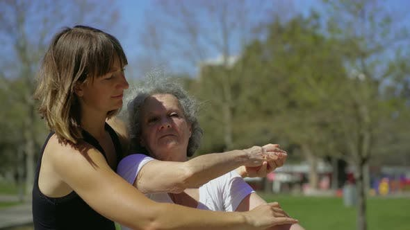 Thumbnail for Personal Coach with Elderly Client in Summer Park