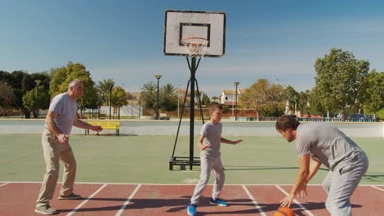 Thumbnail for Multigeneration Family Playing Basketball on Outdoor Court