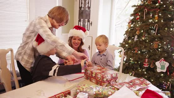 Thumbnail for Happy family wrapping christmas presents together