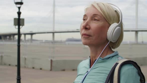 Thumbnail for Woman Listening to Music Outdoors