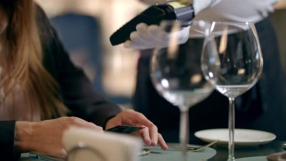 Thumbnail for Female Hand Paying By Bank Card in Restaurant. Contactless Payment