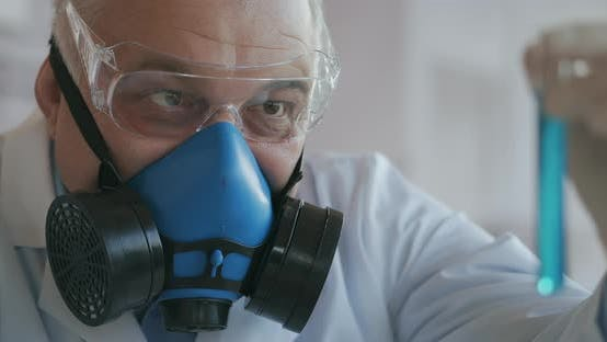 Thumbnail for A Scientist at a Pharmaceutical Company Developing Drugs Wearing a Blue Respirator and Safety