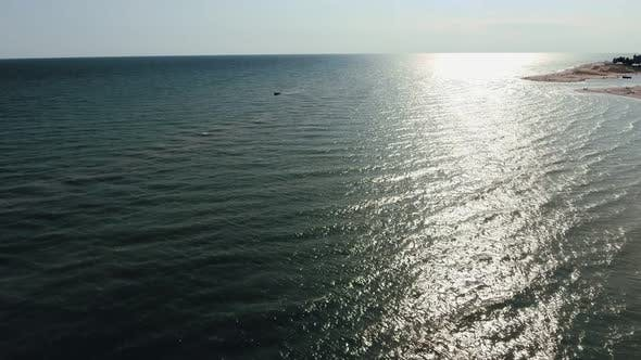 Thumbnail for Aerial Shot of Beautiful Sun Path on the Black Sea Waves at Sunset in Summer