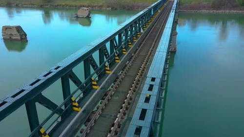 Train Tracks Cross a Steel Bridge
