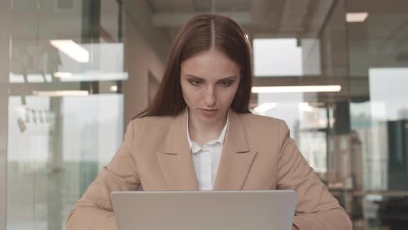Thumbnail for Beautiful Caucasian Businesswoman Working on Laptop