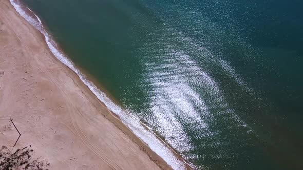 Seascape, calm sea, sandy beach, aerial view