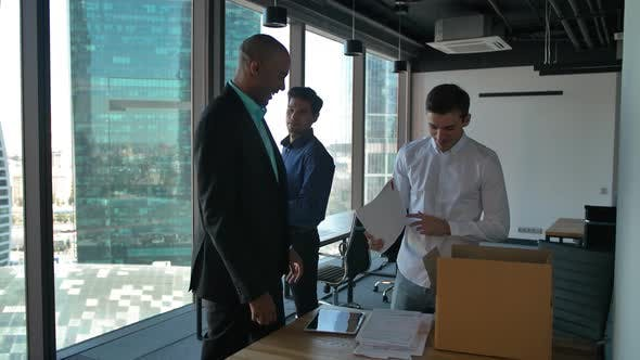 Thumbnail for Business People Unpacking Items Inside of New Modern Office