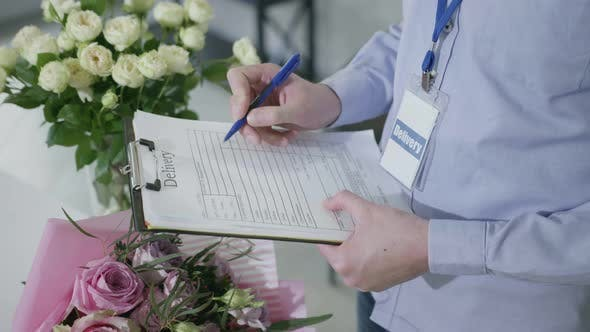 Thumbnail for Delivery, Closeup Hands of Man Checking Order Form for Delivery of Bouquets From Flower Shop, Small