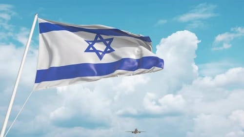 Commercial Airplane Landing Behind the Israeli Flag