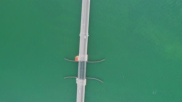 Thumbnail for Aerial Above Bridge Road Following White Car Over Green Water Florida Keys