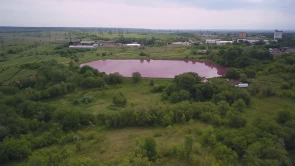 Reservoir with Pink Water, Aerial View, Ecological Catastrophe
