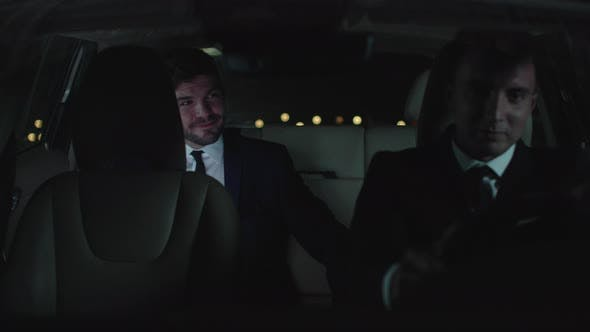 Thumbnail for Businessman and Driver in Car at Night