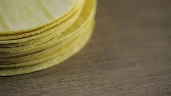 Thumbnail for Fresh yellow corn tortillas on a wood background.