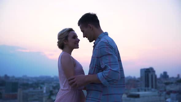 Cover Image for Loving Guy Turning His Beautiful Lady in Dance on The Open Terrace, Cityscape